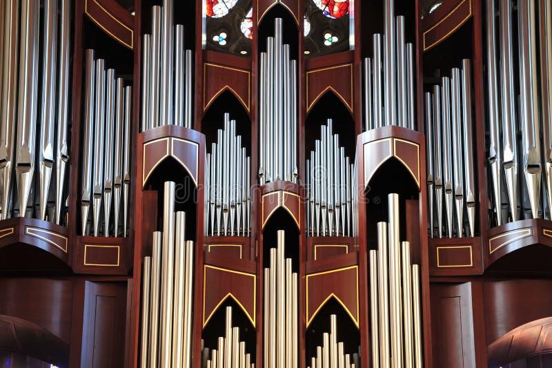 Pipe organ. Detail look of a historic pipe organ in church stock photos