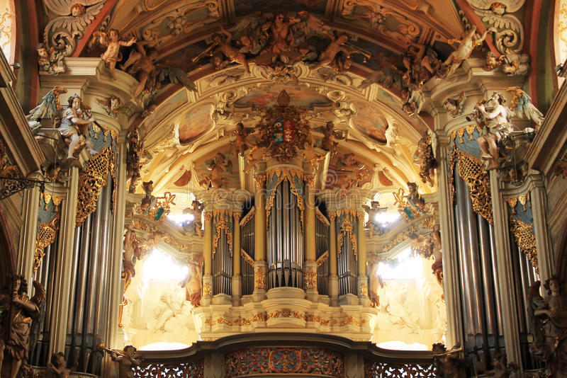 Pipe organ in basilica. Interior of basilica with pipe organ and beautiful baroque statues and paintings in Olomouc, Czech Republic royalty free stock photo