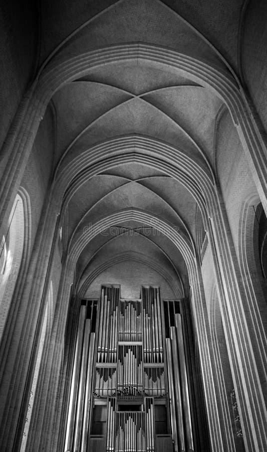 Pipe organ and ceiling inside Grundtvig`s Church. The pipe organ and the ceiling inside Grundtvig`s Church in Copenhagen, Denmark stock images