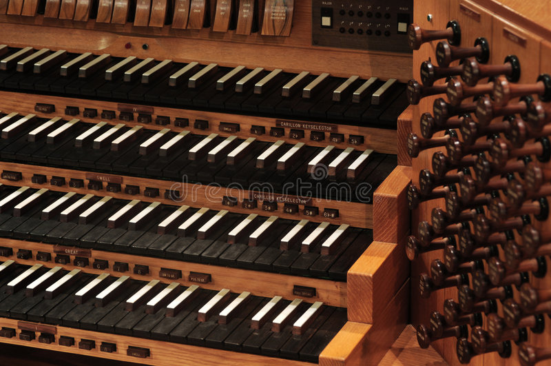 Pipe organ keyboard. Vintaghe pipe organ keyboard with stops stock photo