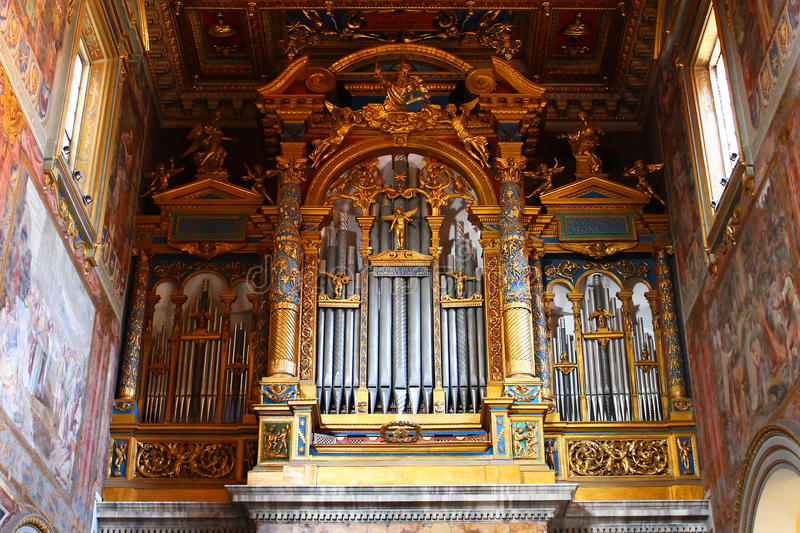 Pipe organ from large italian cathedral, golden details royalty free stock photos