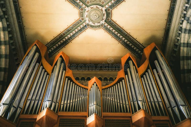 Pipe organ musical instrument performance equipment background.  royalty free stock image