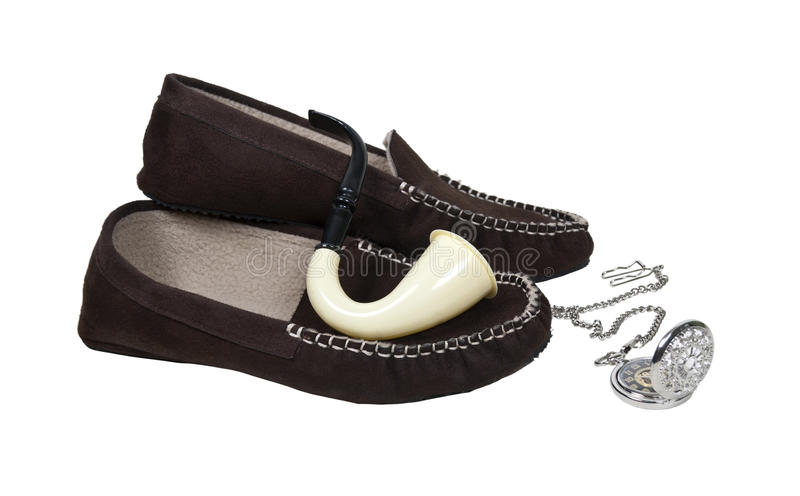 Pipe with Slippers and a Silver Pocket Watch royalty free stock images
