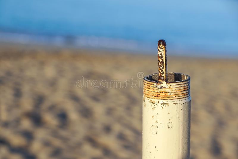 Pipe threaded both isolated on beach at background stock photos