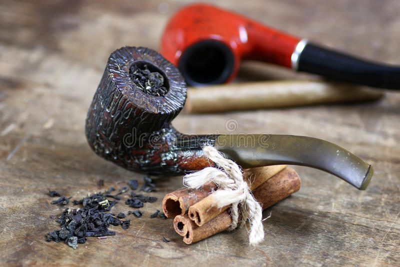 Pipe tobacco table wooden stock image