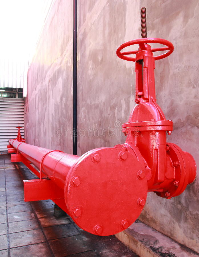 Pipe and Valve of Fire fighting system. Pipes and valves of the sprinkler system in the automotive industry royalty free stock photos