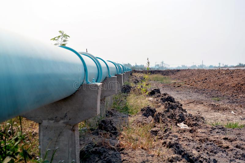 Pipe Water Supply Pipe to The Utility with Concrete poles,blue water pipe on concrete poles, stock image