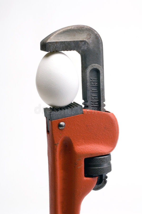 Download Pipe Wrench With An Egg In It's Jaws Stock Image - Image: 8118825