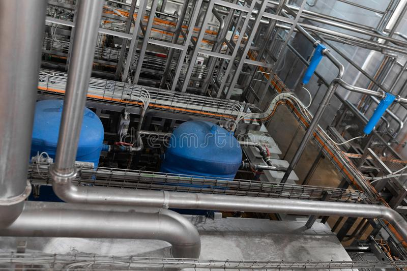 Pipeline and blue tanks. Pressure supply system stock photos