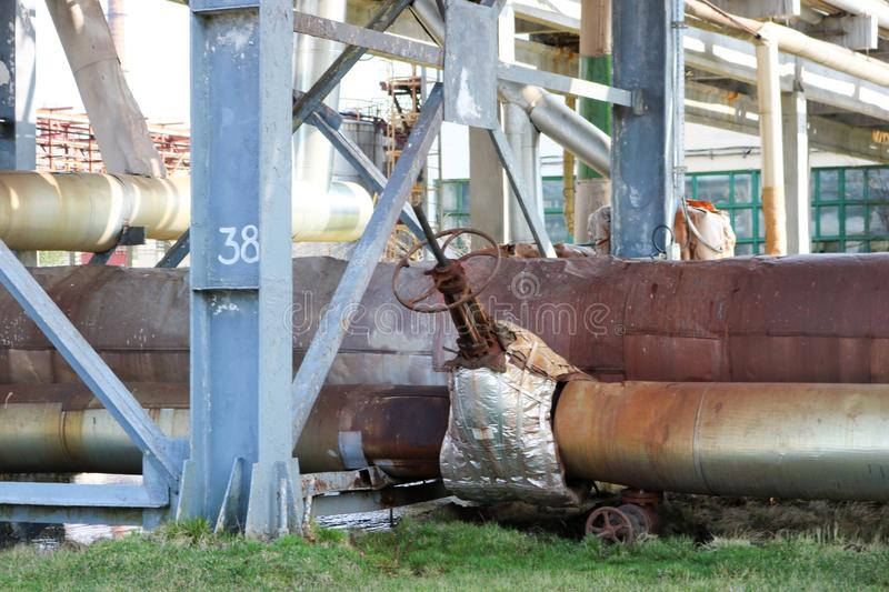 Pipeline estocada, pipes with steam and condensate in isolation, with a large gate valve with quick-detachable insulation with blu royalty free stock image