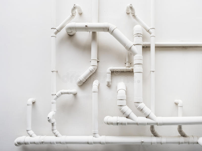 Pipeline Plumbing system on white wall stock photo