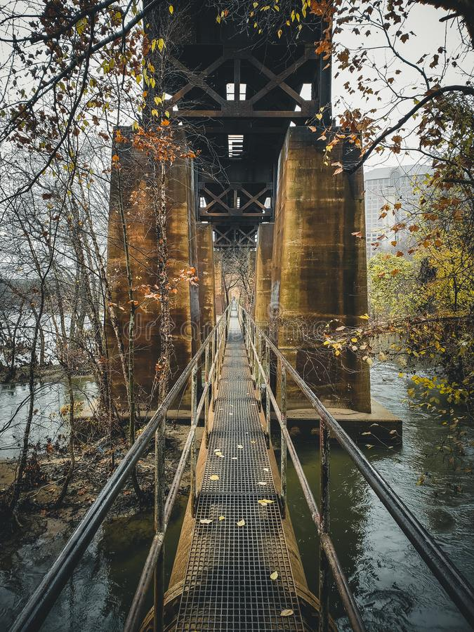 Pipeline Trail under the railroad trestle royalty free stock images