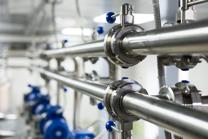 Pipelines from stainless steel, a system for pumping liquids for the food industry. stock photography