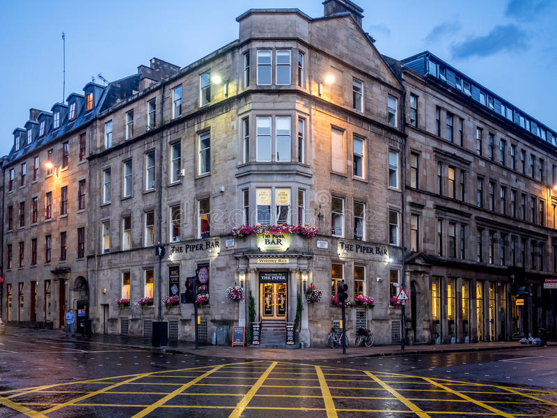 The Piper Bar in Glasgow, Scotland. Glasgow Scotland: The Piper Bar in Glasgow, Scotland. The Piper Bar is a popular pub and whisky bar across the street from stock image