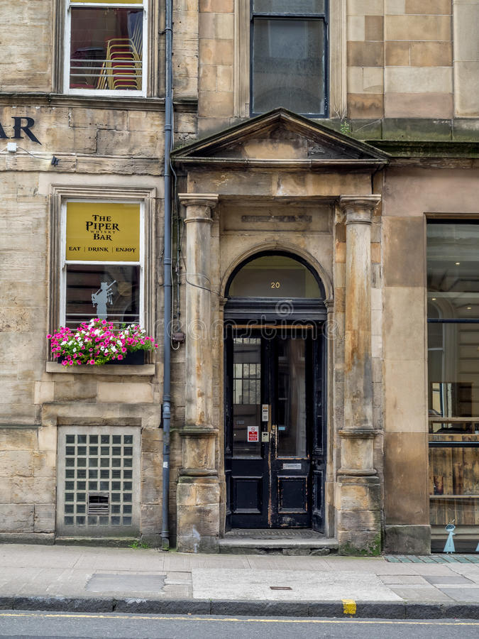 The Piper Bar in Glasgow, Scotland. Glasgow Scotland: The Piper Bar in Glasgow, Scotland. The Piper Bar is a popular pub and whisky bar across the street from stock images