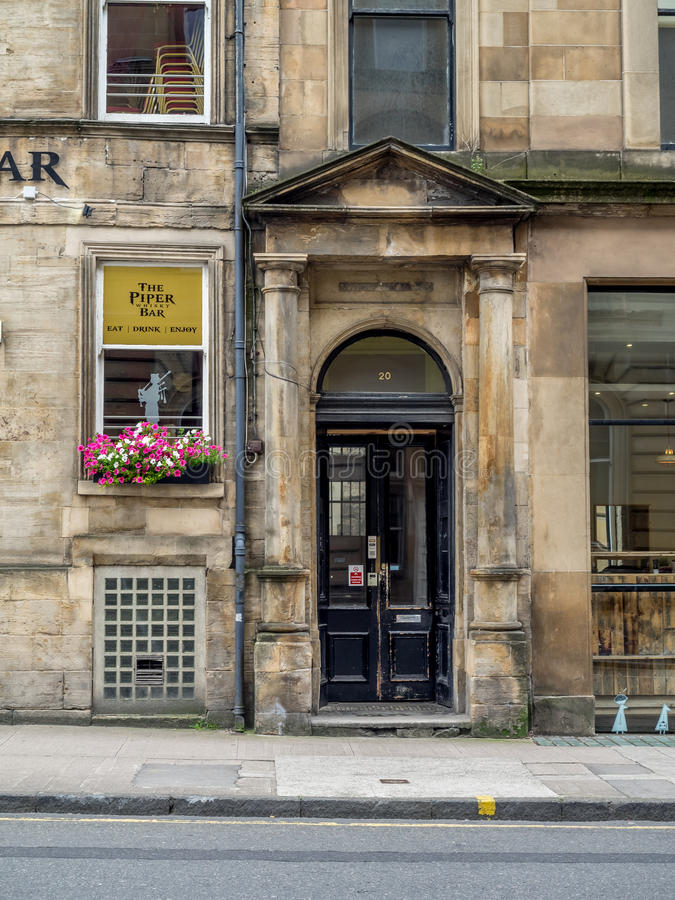 The Piper Bar in Glasgow, Scotland. Glasgow Scotland: The Piper Bar in Glasgow, Scotland. The Piper Bar is a popular pub and whisky bar across the street from royalty free stock photos
