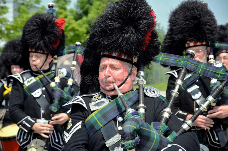 Piper at Braemar. An image of a Piper playing in the massed bands stock image