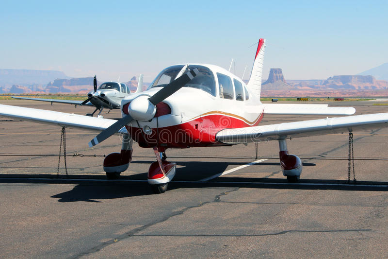 Piper Cherokee - General Aviation. A Piper Cherokee PA-28 on the tarmac in Arizona. Several buttes can be seen in the background royalty free stock photos