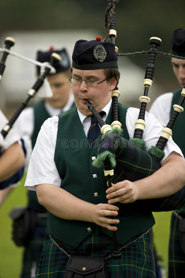 Piper at the Cowal Gathering in Scotland royalty free stock photography