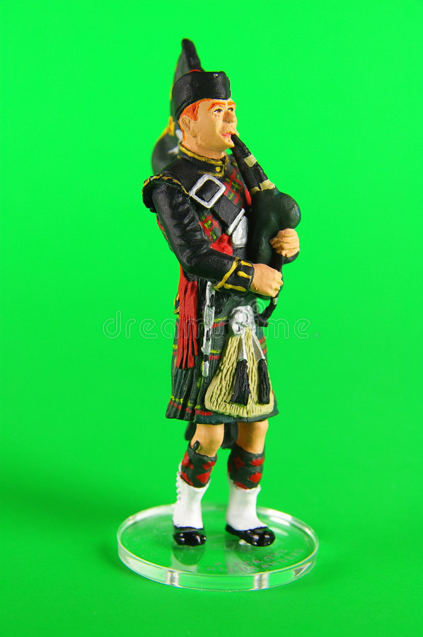 Piper the Highlander. Toy isolated on green background royalty free stock photography