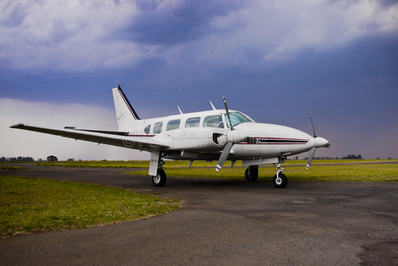 Piper Navajo PA-31 - Side View. Twin piston engine powered aircraft. Maximum passengers 7. Speed 175kts (325km/h). Endurance 5 hours. Range 1460km with required stock photography