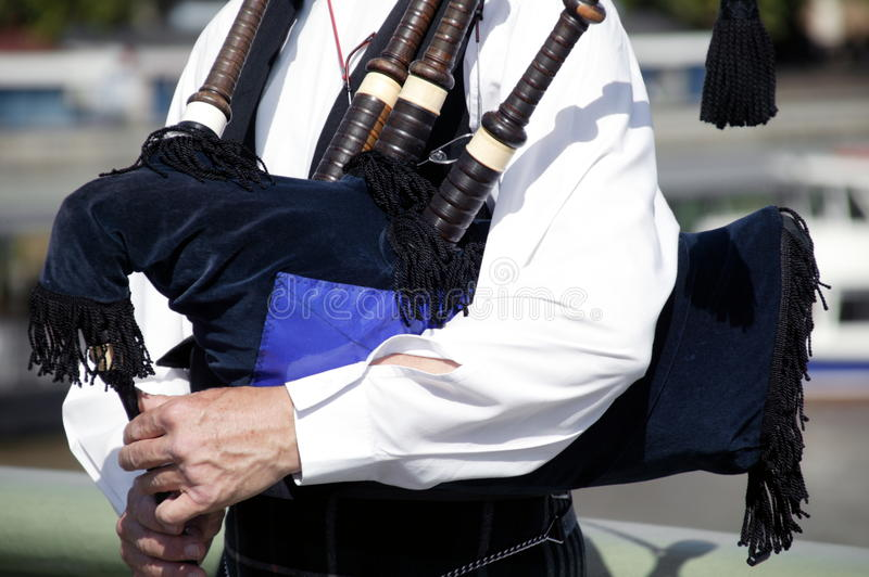 Piper playing bagpipes. Piper playing traditional Scottish / Irish bagpipes stock photography
