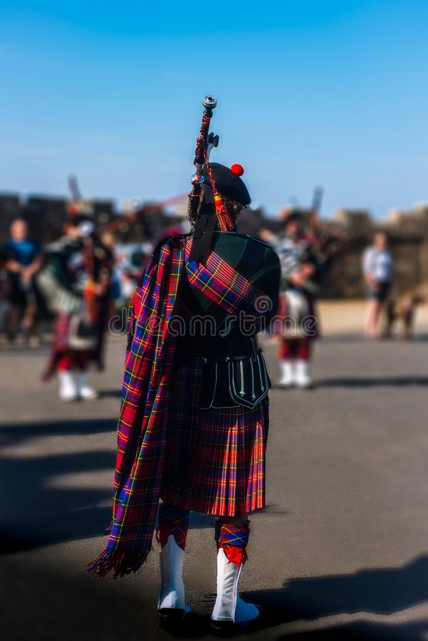 Pipers Wearing Kilts  Perform a Bagpipe Concert  At a Castle in Scotland. Summer Bagpipe Performance at a Castle in Scotland stock image