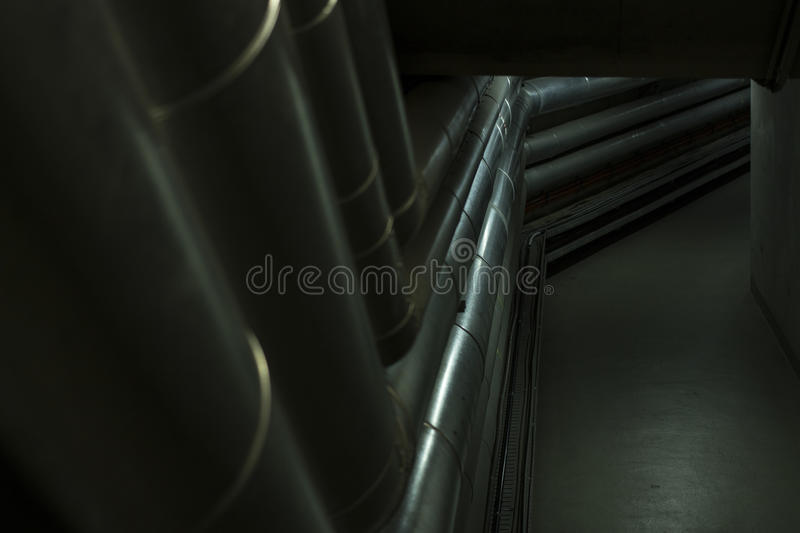 Pipes in the basement. Pipes in the dark basement royalty free stock images