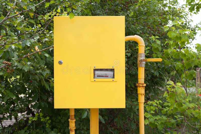 Pipes and gas-meter on nature background. Pipes and gas-meter on nature background stock photography