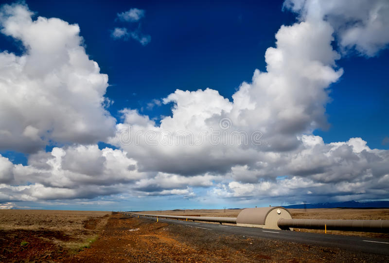 Pipes from heating plant. In lava field in Iceland stock image