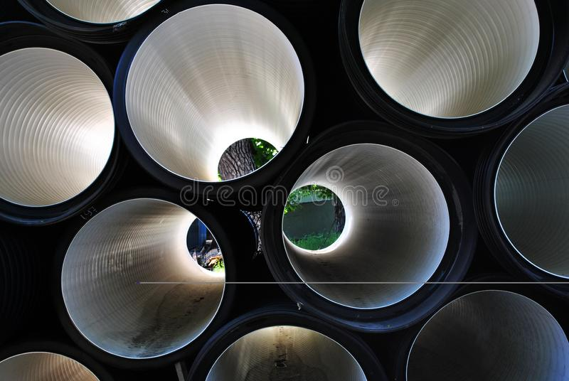 Pipes inside view, shiny metallic surface background stock photo