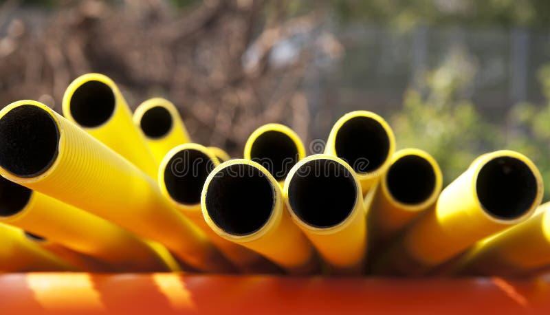 pipes plast-yellow royaltyfria bilder