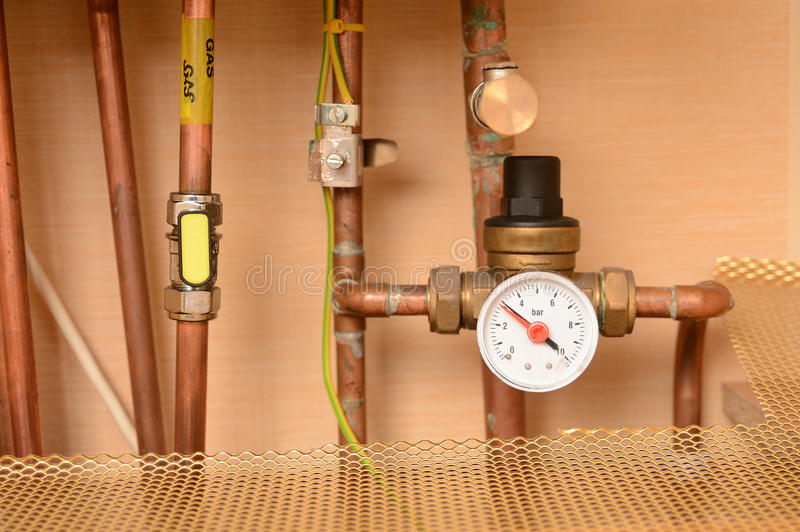 Pipes and pressure gauge royalty free stock image