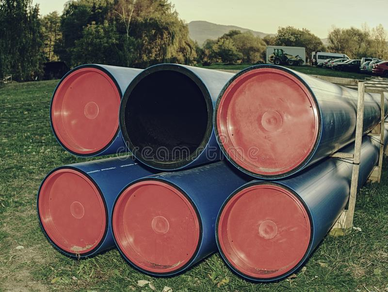 Pipes of PVC large diameter prepared for laying royalty free stock image