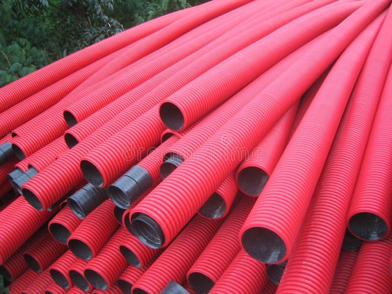 Pipes rouges de PVC images libres de droits