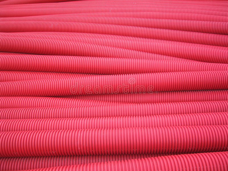 Pipes rouges de PVC photos libres de droits