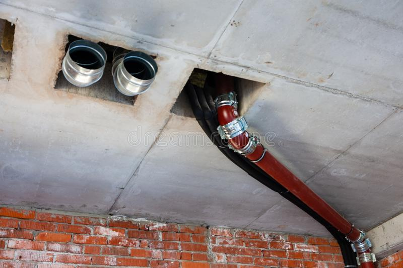 Pipes of sewage, ventilation, water supply in the created interior royalty free stock photos