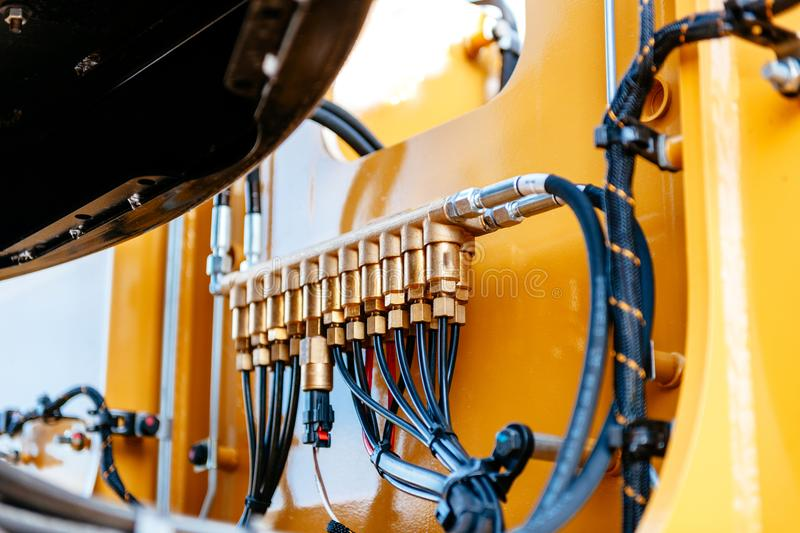 Pipes and tubes of the hydraulic system of a modern excavator tr royalty free stock photo