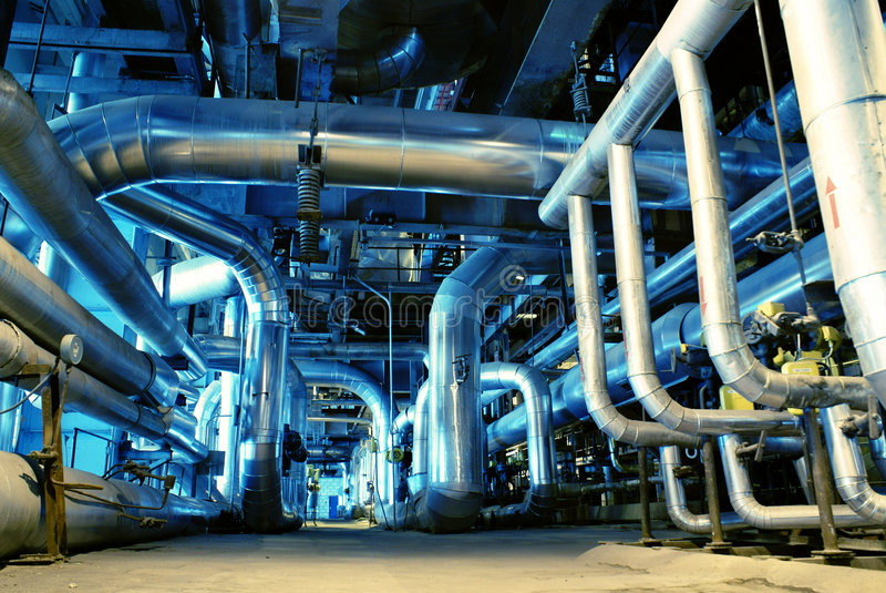Pipes, tubes, machinery and steam turbine stock photo
