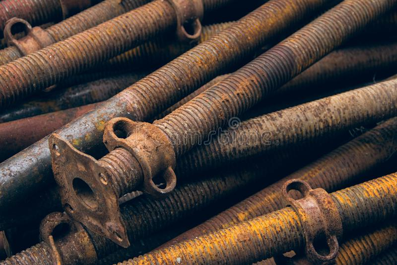 Pipes used for fastening wooden beams during the construction of concrete. Metal supports for scaffolding and formwork royalty free stock image