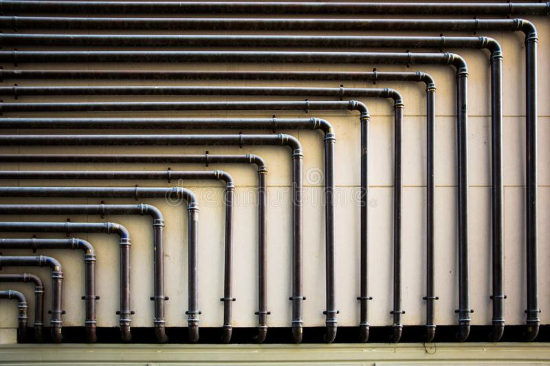 Piping on the wall with geometric shapes royalty free stock photo