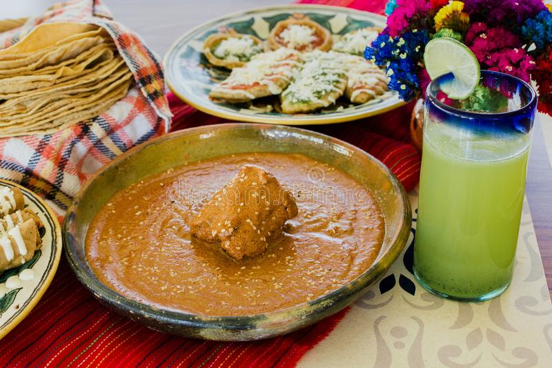 Pipian rojo, Traditional Mexican Food in mexico city. Mexican Feast in a talavera plate royalty free stock photos