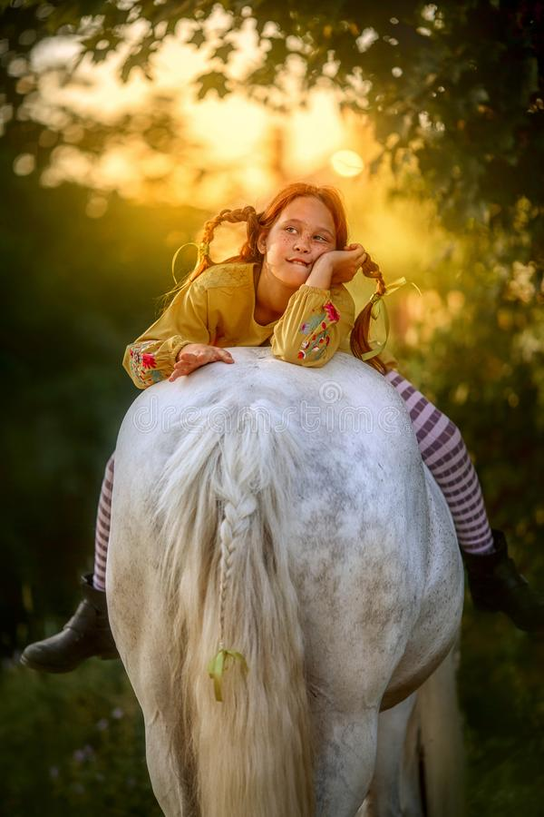 Pippi Longstocking with her horse stock images