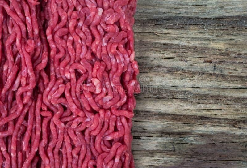 Pique el fondo de la carne y de madera fotografía de archivo