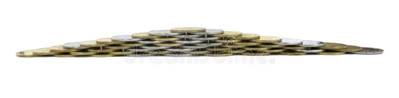 Pirâmide da moeda no fundo isolado imagem de stock