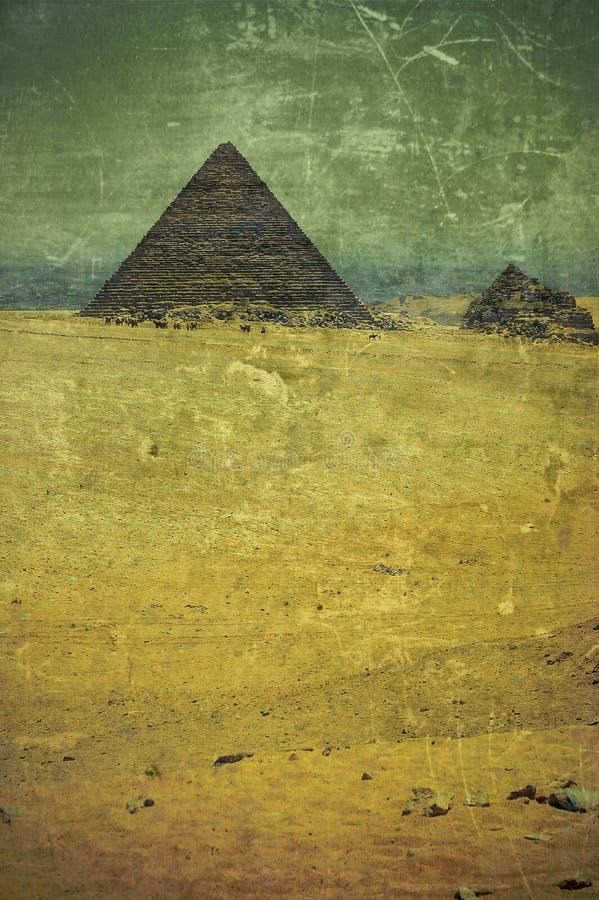 Pirâmides velhas da foto de Grunge em Egipto fotos de stock royalty free