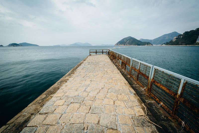 Pir på avvvisandefjärden, i Hong Kong, Hong Kong royaltyfri bild