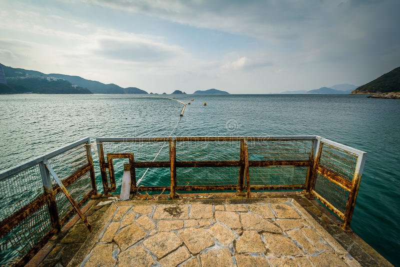 Pir på avvvisandefjärden, i Hong Kong, Hong Kong fotografering för bildbyråer