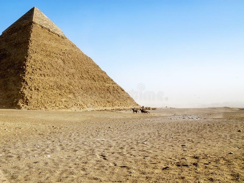 Piramide, ruiters, onweer royalty-vrije stock foto