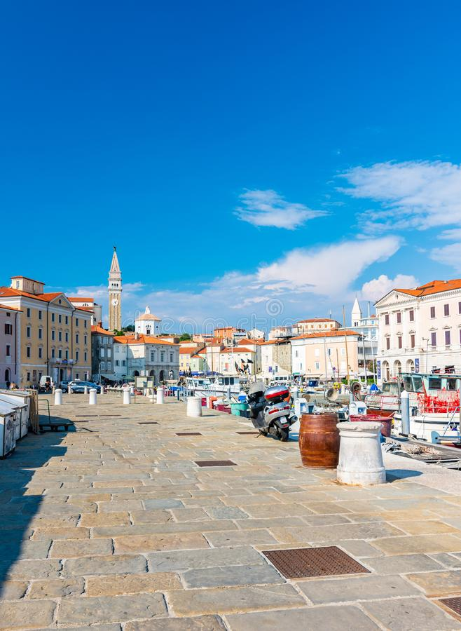 Piran Slovenia: View from Piran harbor to church tower in medieval city. Historic houses and ancient architecture in Slovenia royalty free stock images